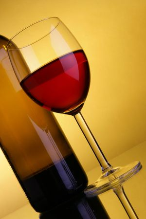 Still-life with red wine over yellow background Stock Photo - 2806650