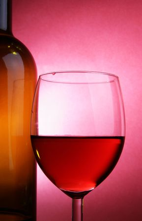 Glass of rose wine over red background Stock Photo - 2847221