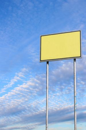 Small blank sign against deep blue sky background Stock Photo - 2900813