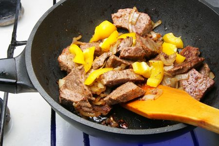 Fry-up beef, onion and yellow pepper in pan photo