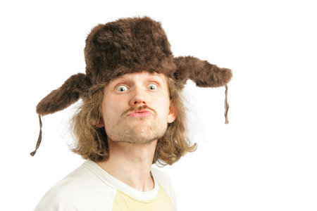 russian man: Crazy russian man with ear-flaps cap isolated over white background Фото со стока