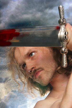warrior sword: Fighting warrior over cloudy background