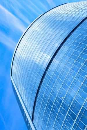 Modern skyscraper close-up under blue sky with clouds Stock Photo - 3233770