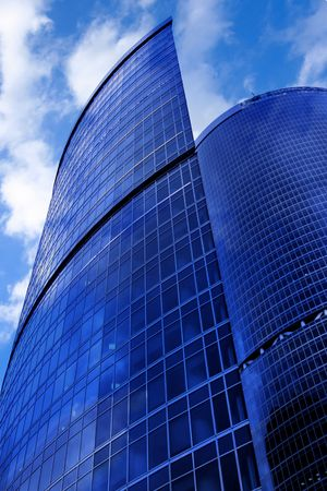 Modern skyscrapers close-up under blue sky with clouds photo