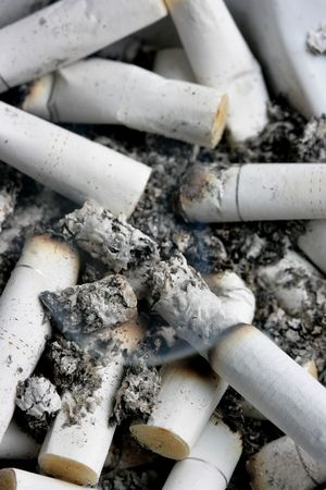 Lots of cigarettes stubs in ashtray. Shallow DOF! photo