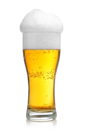Glass of beer with froth isolated over white background photo