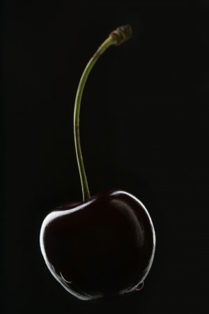 Sweet cherry close-up over black background Stock Photo