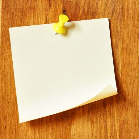 Single blank note paper attached to a wooden wall photo