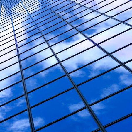 Glass wall of business center and sky reflection, may be used as background photo
