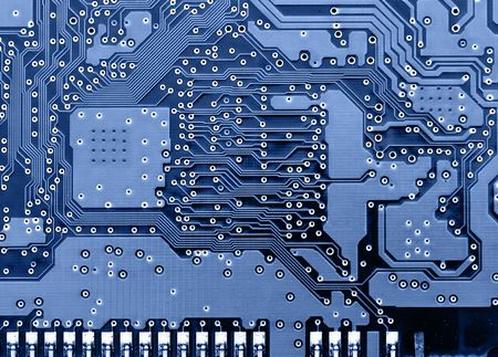 joining services: Circuit board super close-up toned in blue color