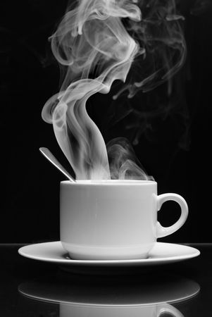 cofee: Cup of hot drink with steam over black background