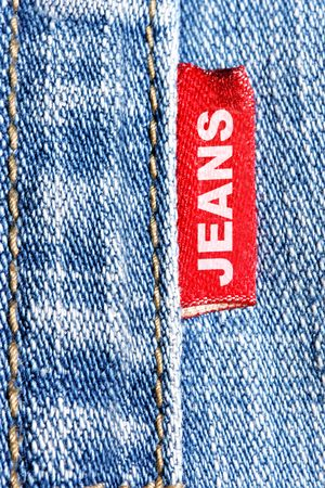 Blue jeans and red label with word Jeans photo
