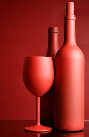 Still-life with red wine bottles and glass photo