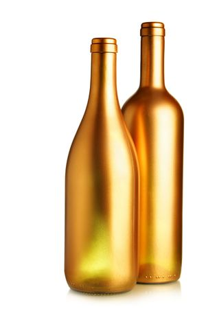 matallic: Two gold wine bottles isolated over white background Stock Photo