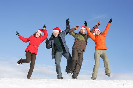 Friends with Santa hats dance on flank of hill Stock Photo - 3519891