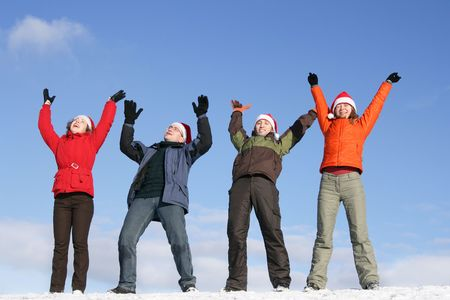 Friends with Santa hats have fun on flank of hill Stock Photo - 3519890