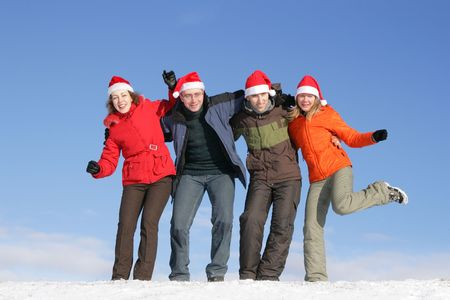 Friends with Santa hats have fun on flank of hill Stock Photo - 3519892