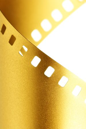 Gold 35 mm film macro isolated over white background photo