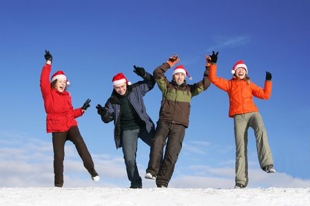 Friends with Santa hats dance on snow Stock Photo - 3550186