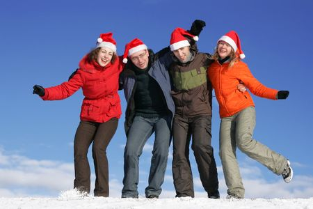 Friends with Santa hats have fun on flank of hill Stock Photo - 3550187