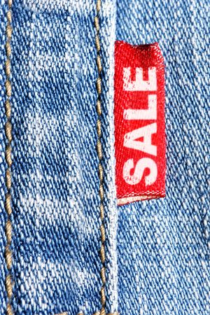 Blue jeans and red label  with word SALE photo
