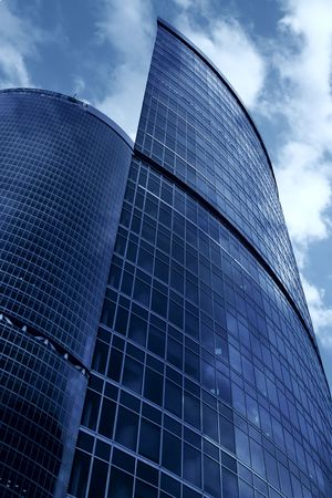 Modern skyscrapers close-up under blue sky with clouds Stock Photo - 3658724