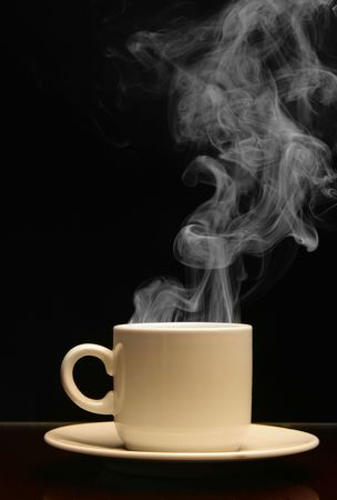 vapour: Cup of hot drink with steam over black background