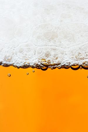froth: Beer and froth close-up, may be used as background Stock Photo