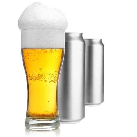 Beer glass and two cans isolated over white background photo