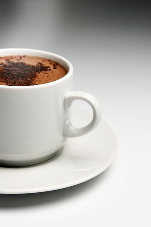Cup of hot coffee over grey background photo