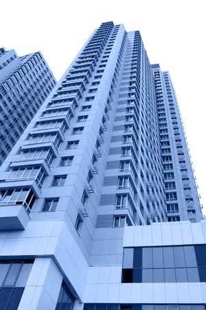 hypothec: Modern apartment buildings toned in blue color over white background