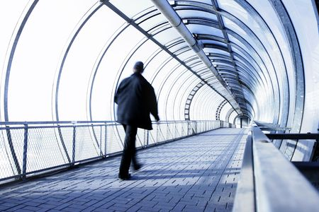 Perspective of the passage and man in motion blur Stock Photo