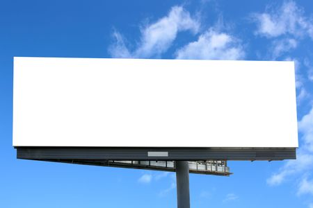 Blank billboard against blue sky, put your own text here photo