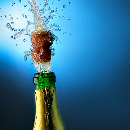 Bottle of champagne with splashes over blue background Stock Photo - 3829686