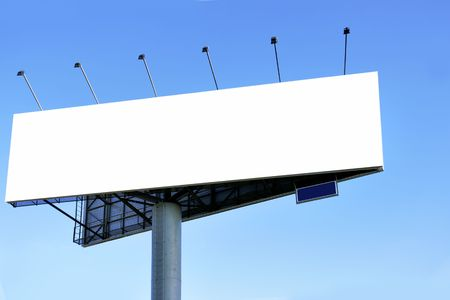 Blank big billboard over blue sky, put your own text here photo