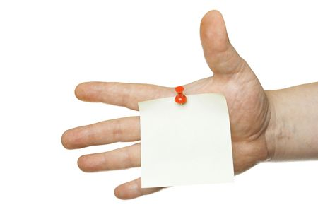 Single blank note paper attached to a human hand photo