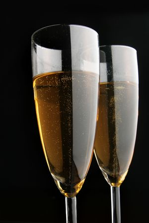 Two glasses of champagne close-uo over black background Stock Photo - 3865464