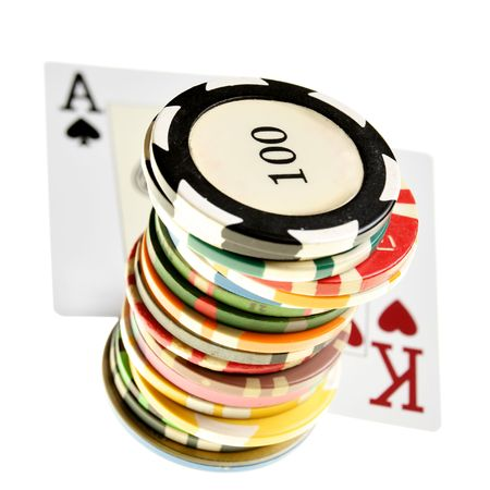 Ace - king offsuit and colorful chips isolated over white background photo