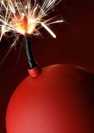 Red bomb with burning fuse close-up Stock Photo - 3899295