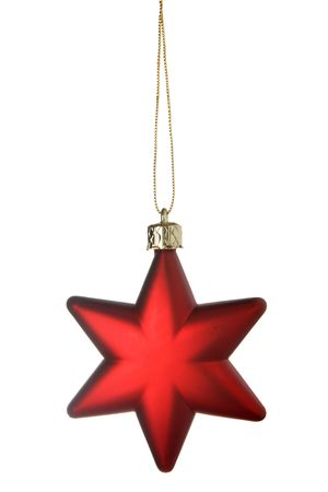 Red Christmas star isolated over a white background photo