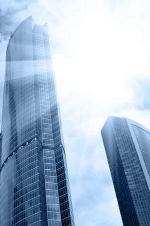 Modern skyscrapers close-up and sun glare