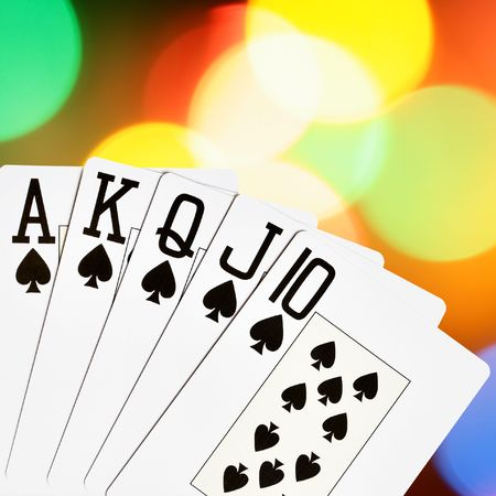 Spades royal flush close-up over colorful background photo