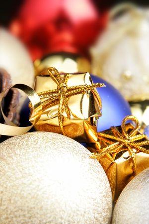Gold gift box and christmas balls close-up photo