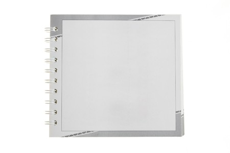 Blank notebook isolated over white background photo