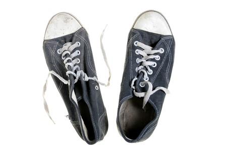 threadbare: Threadbare gym-shoes isolated over white background