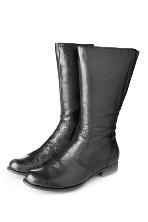 Black female boots isolated over white background photo