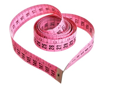 Measuring tape looking as heart isolated over white background Stock Photo - 4136907