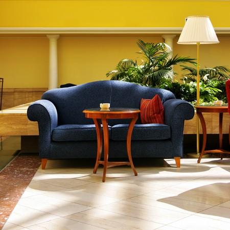 Interior of atrium with blue divan and lamp Stock Photo - 4165981