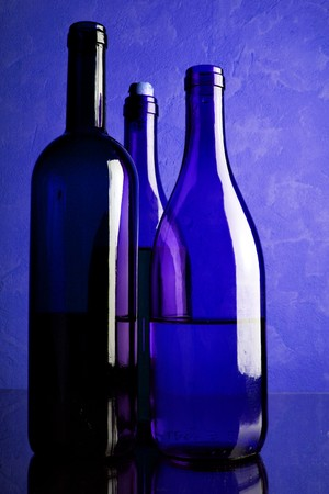 Still-life with three wine bottles toned in blue color Stock Photo - 4165985