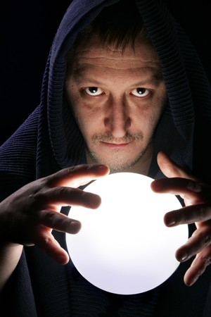 Wizard with glowing magical ball close-up photo